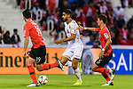 Abdulla Yusuf Helal of Bahrain (C) fights for the ball with Jung Wooyoung of South Korea (R) and Kim Younggwon of South Korea (L) during the AFC Asian Cup UAE 2019 Round of 16 match between South Korea (KOR) and Bahrain (BHR) at Rashid Stadium on 22 January 2019 in Dubai, United Arab Emirates. Photo by Marcio Rodrigo Machado / Power Sport Images