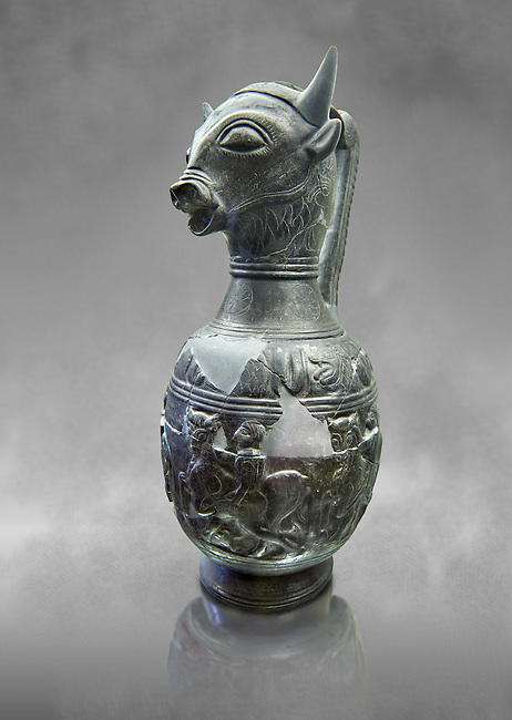Three quarters view of the 6th century BC Etruscan Bull headed bucherro style oinochoe, or wine jug,  made in Chuisi and excavated from the necropolis de Fonte Rotella, inv 3190, National Archaeological Museum Florence, Italy  , grey art background