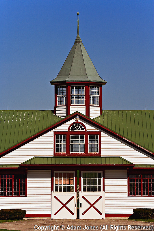 Distinctive red, white, and green colors of horse barn, Calumet Farm, Lexington, Kentucky