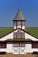 Distinctive red, white, and green colors of horse barn, Calumet Farm, Lexington, Kentucky