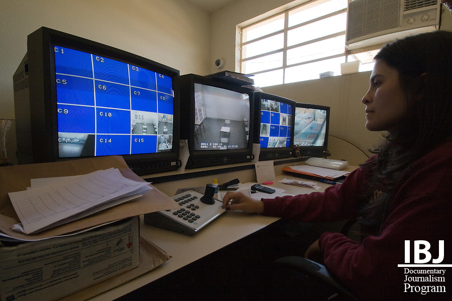 A woman watches the cameras at a prison for adolescents where the staff is keen to reduce the presence of guards and relies more on recorded video for supervision. IBJ Fellow Dr. Saliba is programming educational materials for local communities to inform them of their rights to habeas corpus.