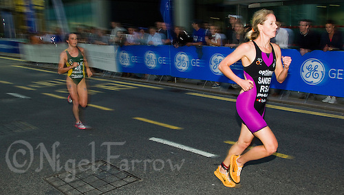 28 JUN 2012 - LONDON, GBR - Gillian Sanders (right) leads Ashlee Bailie during the run at the elite women's 2012 Canary Wharf Triathlon final in Canary Wharf, London, Great Britain .(PHOTO (C) 2012 NIGEL FARROW)