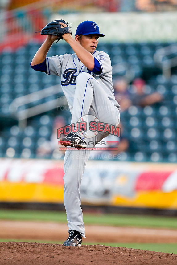 Josh Sullivan (13) of the Tulsa Drillers winds up during a game against the Springfield Cardinals at Hammons Field on July 18, 2011 in Springfield, Missouri. Tulsa defeated Springfield 13-8. (David Welker / Four Seam Images)