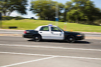 A speeding Austin Police Department (APD) police car, responds to emergency call on the streets of downtown Austin.<br />
