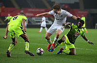 Pictured: George Byers of Swansea City (C) is tackled by a Reading player Monday 15 May 2017<br /> Re: Premier League Cup Final, Swansea City FC U23 v Reading U23 at the Liberty Stadium, Wales, UK