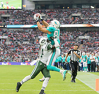 04.10.2015. Wembley Stadium, London, England. NFL International Series. Miami Dolphins versus New York Jets. Miami Dolphins Tight End Jordan Cameron catches the ball in the End Zone whilst being tackled.