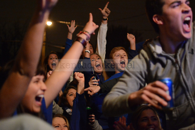 UK students celebrate on State street after the UK Wildcats men's basketball team beat the Louisville Cardinals 74-69 in Lexington, Ky., on Friday, March 28, 2014. Photo by Caleb Gregg | Staff