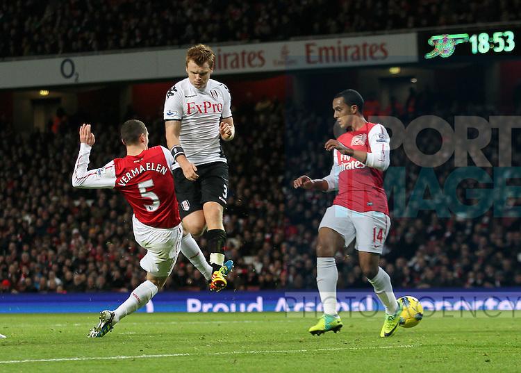 Arsenals Thomas Vermaelen scoring an own goal to put Fulham 1-0 up