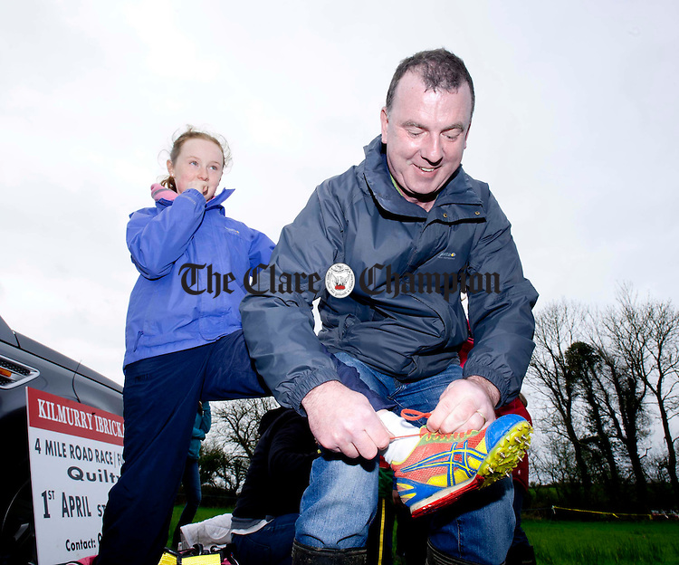 Pat Keane from Miltown gives his daughter Áine a helping hand ahead of the Clare Athletics Association's Cross-Country Relays in Newmarket. Photograph by Declan Monaghan
