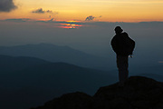 Appalachian Trail - A hiker enjoys the sunset from Mount Clay. Located in the White Mountains, New Hampshire USA