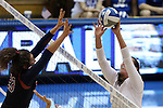 11 September 2015: Stanford's Jordan Burgess (23) tries to block against Duke's Emily Sklar (right). The Duke University Devils hosted the Stanford University Cardinal at Cameron Indoor Stadium in Durham, NC in a 2015 NCAA Division I Women's Volleyball contest. Stanford won the match 3-2 (17-25, 25-22, 17-25, 25-23, 10-15).