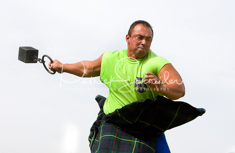 A competitor throws the weight in the heavy Scottish Athletic Events during the 52nd Annual Grandfather Mountain Highland Games in Linville, NC.