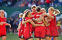 Portland, Oregon - Sunday September 4, 2016: The Thorns celebrate after Portland Thorns FC midfielder Allie Long (10) scored a goal during a regular season National Women's Soccer League (NWSL) match at Providence Park.