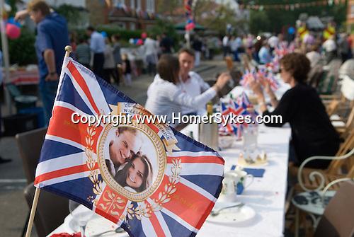 Royal Wedding Street Party. Barnes London. Prince William Kate Middleton Princess Catherine souvenir Union Jack Flag. April 29 2011.