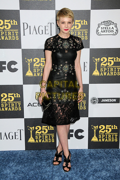 CAREY MULLIGAN.25th Annual Film Independent Spirit Awards - Arrivals held at the Nokia Event Deck at L.A. Live, Los Angeles, California, USA..March 5th, 2010.full length black dress leather clutch bag pattern beads beaded lace .CAP/ADM/BP.©Byron Purvis/AdMedia/Capital Pictures.