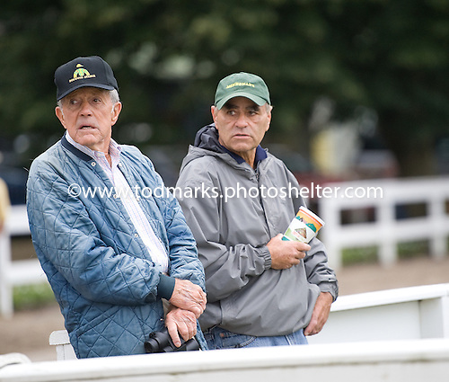 Trainer Neil Howard, at right next to Cot Campbell, returns to Saratoga after an absence.