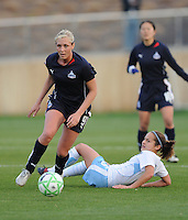 Washington Freedom midfielder Allie Long (9) beats Chicago Red Stars midfielder Brittany Klein (6) for possession.  Washington Freedom tied Chicago Red Stars 1-1 at The Maryland SoccerPlex, Saturday April 11, 2009.