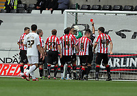 Pictured: Shane Lowry of Sheffield United (behind teammates) is shown a red card by refereeE L Ilderton for saving the ball with his hand from a kick by Scott Sinclair of Swansea which earned the latter team with a penalty scored by the same player. Saturday 07 May 2011<br /> Re: Swansea City FC v Sheffield United, npower Championship at the Liberty Stadium, Swansea, south Wales.