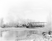 D&amp;RGW #268 pushing dismantling train across steel truss bridge north of Gunnison.<br /> D&amp;RGW  River Crossing North of Gunnison, CO
