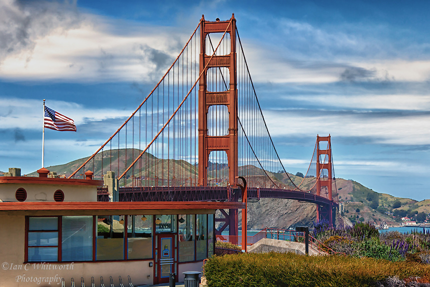 A scenic view looking across the impressive Golden Gate bridge in San Francisco.