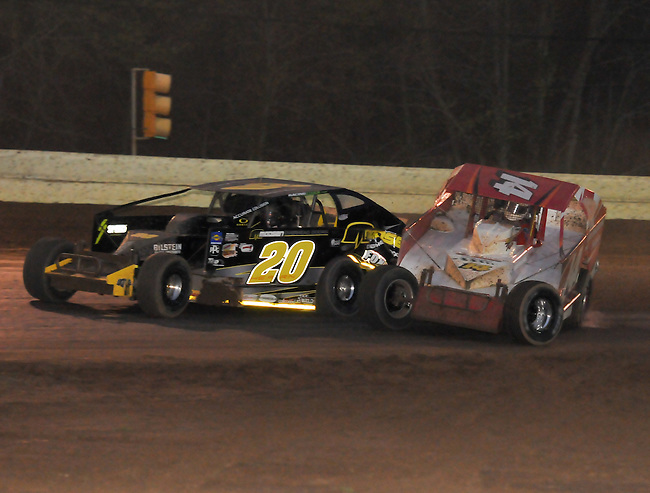 Doug Manmiller and Brett Hearn tangle on the last lap in turn 3-4 during the Roc Poker Series 60 at Bridgeport Speedway