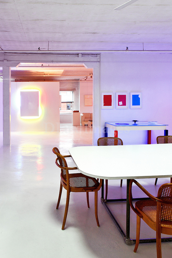 modern dining room with artworks