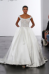 Model walks runway in an off-the-shoulder beaded Chantilly bodice with ball gown skirt and beaded appliqués at hem, from the Dennis Basso for Kleinfeld 2018 Bridal Collection on October 5 2017, during New York Bridal Fashion Week.
