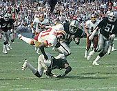 Washington Redskins wide receiver Art Monk (81) is tackled after a reception against the Los Angeles Raiders at RFK Stadium in Washington, D.C. on October 2, 1983.  The Redskins won the game 37 - 35.<br /> Credit: Howard L. Sachs / CNP