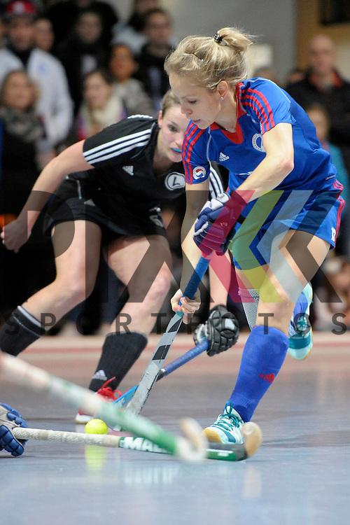 GER - Mannheim, Germany, January 30: During the 1. Bundesliga Damen indoor hockey quarter final match between Mannheimer HC (blue) and TuS Lichterfelde (black) on January 30, 2016 at Irma-Roechling-Halle in Mannheim, Germany.   Lydia Haase #12 of Mannheimer HC<br /> <br /> Foto &copy; PIX-Sportfotos *** Foto ist honorarpflichtig! *** Auf Anfrage in hoeherer Qualitaet/Aufloesung. Belegexemplar erbeten. Veroeffentlichung ausschliesslich fuer journalistisch-publizistische Zwecke. For editorial use only.