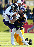 MANKATO, MN - NOVEMBER 1:  Garrett Shutt #24 for the University of Sioux Falls is brought down by Tyler Henderson #33 from Minnesota State Mankato in the second quarter Saturday afternoon at Blakeslee Stadium in Mankato. (Photo by Dave Eggen/Inertia)