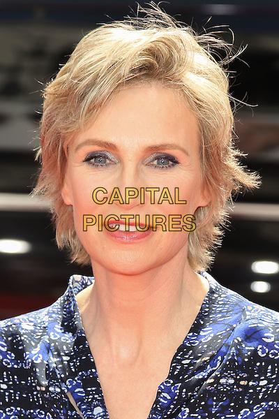 "JANE LYNCH.World Premiere of ""The Three Stooges: The Movie,"" at Grauman's Chinese Theatre in Hollywood. Hollywood, CA USA. .April 7th, 2012.headshot portrait blue print shirt blouse .CAP/CEL .©CelPh/Capital Pictures."