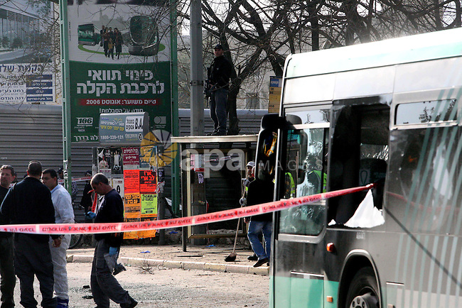 Israeli police patrol at the scene of a bomb attack at a bus station in Jerusalem blowing up next to the bus and near a kiosk, called the 'Explosive Kiosk', on 23 March 2011. Over 30 people were injured by a parcel bomb that was left on the side of the road, not on a bus itself, according to the police, and one 60-year-old woman died from her wounds.Photo by Sliman Khader