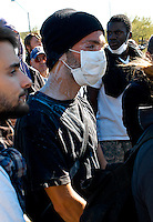 AJ ALEXANDER/AAP - Peper sprayed and the wet down with milk to stop the burning pain at an ALEC Protest..Photo by AJ ALEXANDER (c)