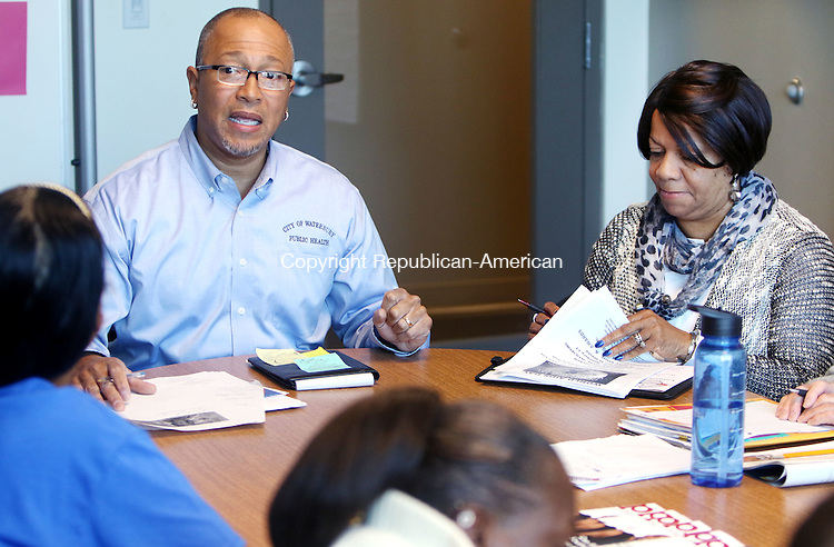WATERBURY CT. 23 November 2015-112315SV08-Sam Bowens III and Joyce Boone both of the Health Department run a meeting to organize a World AIDS Day on December 1st in Waterbury Monday. Waterbury will celebrate it with a candlelight vigil and awards ceremony at Grace Baptist Church at 6 p.m on the 1st.<br /> Steven Valenti Republican-American