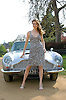 Hayley Westenra<br /> in Hyde Park with an Aston Martin sports car just before attending the Classical Brit Awards at the Royal Albert Hall, Kensington, London. <br /> 4th May 2011<br /> Photograph by Elliott Franks