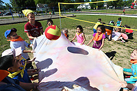 NWA Democrat-Gazette/J.T. WAMPLER Third and fifth graders work together to get a ball over a net using a sheet Thursday May 25, 2017 during Field Day at Frank Tillery Elementary School in Rogers. Today (FRIDAY MAY 26) is the last day of school for Rogers schools.