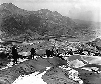 Men of the 19th Inf. Regt. work their way over the snowy mountains about 10 miles north of Seoul, Korea, attempting to locate the enemy lines and positions.  January 3, 1951.  Pfc. James J. Jacquet. (Army)<br /> NARA FILE #:  111-SC-355544<br /> WAR &amp; CONFLICT BOOK #:  1431