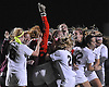 Garden City goalie Caroline Peppard (red jersey) and teammates celebrate after their 1-0 win over South Side in the the Nassau County varsity girls' soccer Class B final at Cold Spring Harbor High School on Tuesday, November 3, 2015.<br /> <br /> James Escher