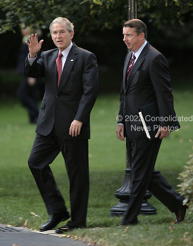 United States President George W. Bush waves as he walks out from the White House in Washington, DC before his departure September 16, 2008. Bush is going to participate in an aerial tour of Texas hurricane damage area. Counselor to the President Ed Gillespie follows behind the President.<br /> Credit: Yuri Gripas / Pool via CNP