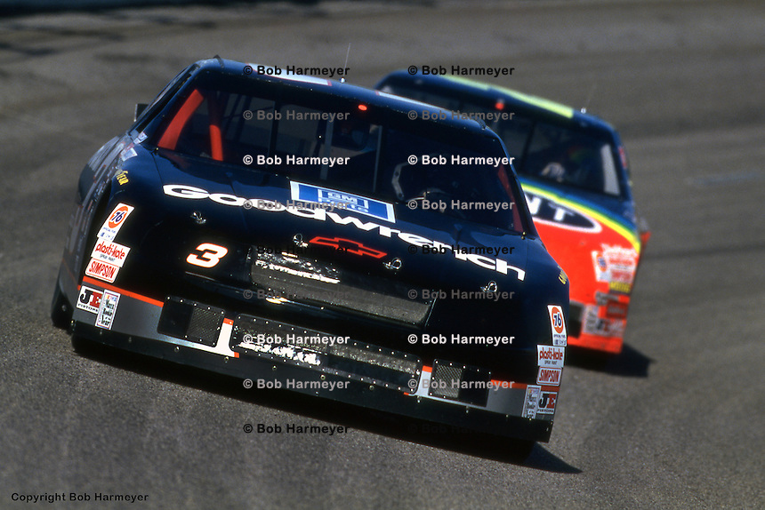 DARLINGTON, SC - MARCH 27: Dale Earnhardt leads Jeff Gordon during practice for the TranSouth Financial 400 on March 27, 1994, at Darlington Raceway near Darlington, South Carolina.