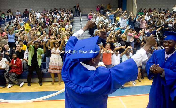 WATERBURY, CT- 16 JUNE 2008- 061608JT06-<br /> Crosby graduate Cornelius Marshal leads the audience to wave their arms to &quot;Lean on Me&quot; as its sung by the faculty choir during graduation ceremonies at Crosby on Monday night. At right is Gary Madison.<br /> Josalee Thrift / Republican-American