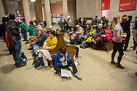 The lobby of the Metropolitan Museum of Art in New York resembles a railroad station waiting room on Sunday, October 23, 2016. (© Richard B. Levine)