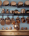 The copper pots and pans on the shelves in the Kitchen at Felbrigg Hall.
