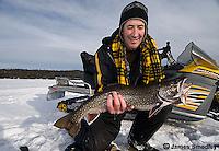 Ice fishing splake in winter