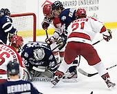 Matt Di Girolamo (UNH - 30), Alex Killorn (Harvard - 19), Trevor van Riemsdyk (UNH - 6), Marshall Everson (Harvard - 21) - The Harvard University Crimson defeated the University of New Hampshire Wildcats 7-6 on Tuesday, November 22, 2011, at Bright Hockey Center in Cambridge, Massachusetts.