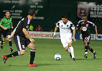 Devon McTavish #18 and Boyzzz Khumalo #17 of D.C. United close in on Javier Morales #11  of Real Salt Lake during an Open Cup match at RFK Stadium, on June 2 2010 in Washington DC. DC United won 2-1.