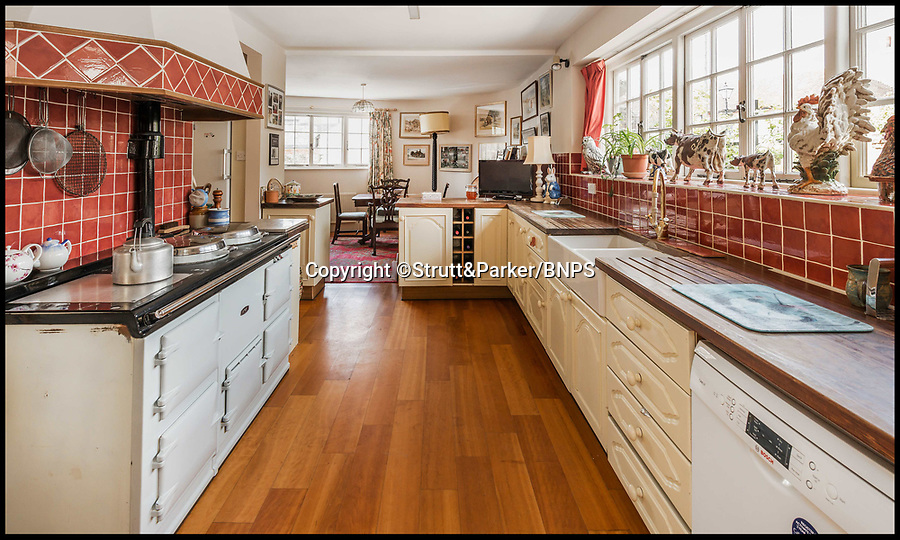 BNPS.co.uk (01202 558833)<br /> Pic: Strutt&Parker/BNPS<br /> <br /> Large kitchen.<br /> <br /> Hello Sailor? - The perfect seaside residence for a lover of the sea.<br /> <br /> A luxury harbourside home with its own private dock in the back garden has launched on to the market - but you'll need a pirates treasure to afford it.<br /> <br /> £3.4million Wharf House is located in one of the country's best sailing communities in Emsworth, Hants, and is surrounded by water.<br /> <br /> From the front it has spectacular views over Chichester Harbour and at the back there is a mooring space for a large boat.