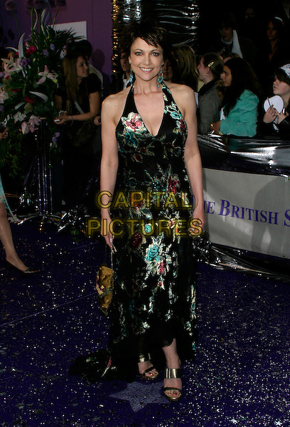EMMA SAMMS.The British Soap Awards - Arrivals, .BBC Television Centre, London, England, .May 20th 2006..full length black and gold patterned floral flower print halterneck dress.REf: AH.www.capitalpictures.com.sales@capitalpictures.com.©Adam Houghton/Capital Pictures.