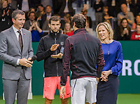 Rotterdam, The Netherlands, 18 Februari, 2018, ABNAMRO World Tennis Tournament, Ahoy, Singles final, Roger Federer (SUI) approaching the runner up  Grigor Dimitrov (BUL), left Tournament director Richard Krajicek and right Ahoy director Jolanda Jansen<br /> Photo: www.tennisimages.com/henkkoster
