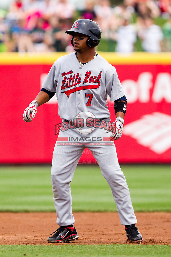 Luis Jimenez (7) of the Arkansas Travelers leads off of second base after hitting a double during a game against the Springfield Cardinals on May 10, 2011 at Hammons Field in Springfield, Missouri.  Photo By David Welker/Four Seam Images.